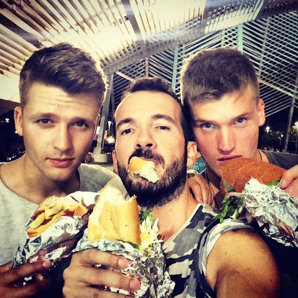 """Living the real """"street food"""" experience during a concert at the Olympic Stadium (here with my friends Miltos & Ilias)."""
