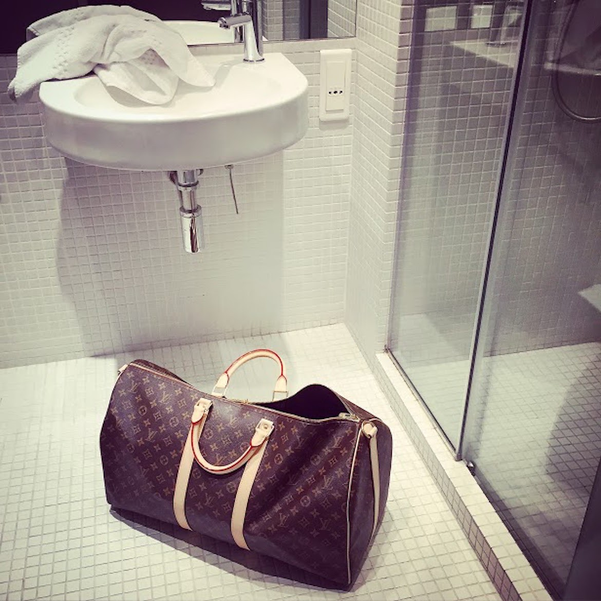 A classic Louis Vuitton Keepall in a bathroom at Periscope Hotel, Kolonaki