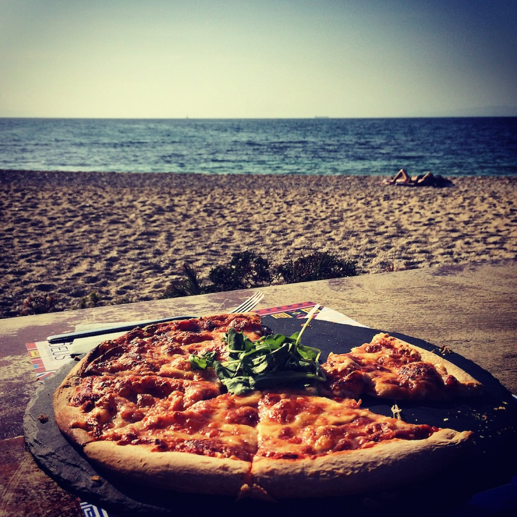 Pizza margherita on Alimos beach on a sunny November day