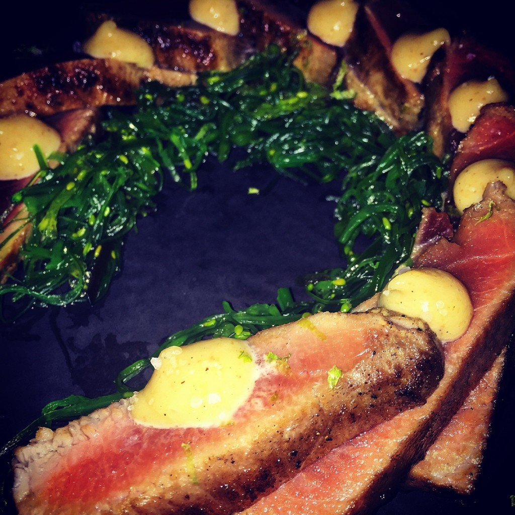 Tuna tataki in a spices crust with lime, hazelnut & wakame seaweed.
