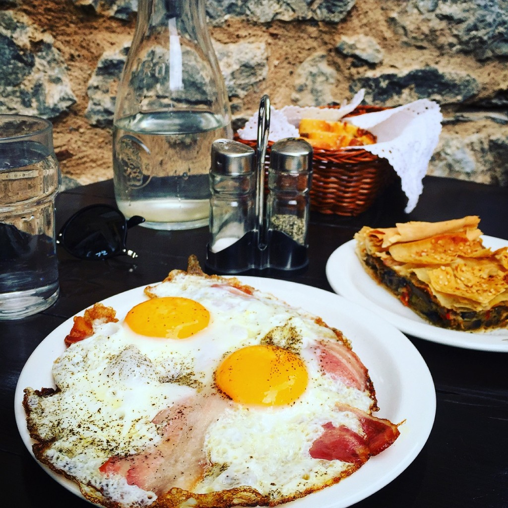 "Yummy late breakfast with eggs, bacon, plus a delicious mushroom pie at ""En Arachovi"" easy-going little cafe"