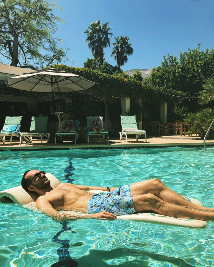 Morning chill-out at the pool wearing swim-shorts by Orlebar Brown (Salt Water) & sunglasses by Saint Laurent (Delux Hellas)