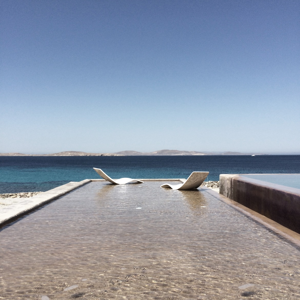 The pool area at a private residence in Mykonos.
