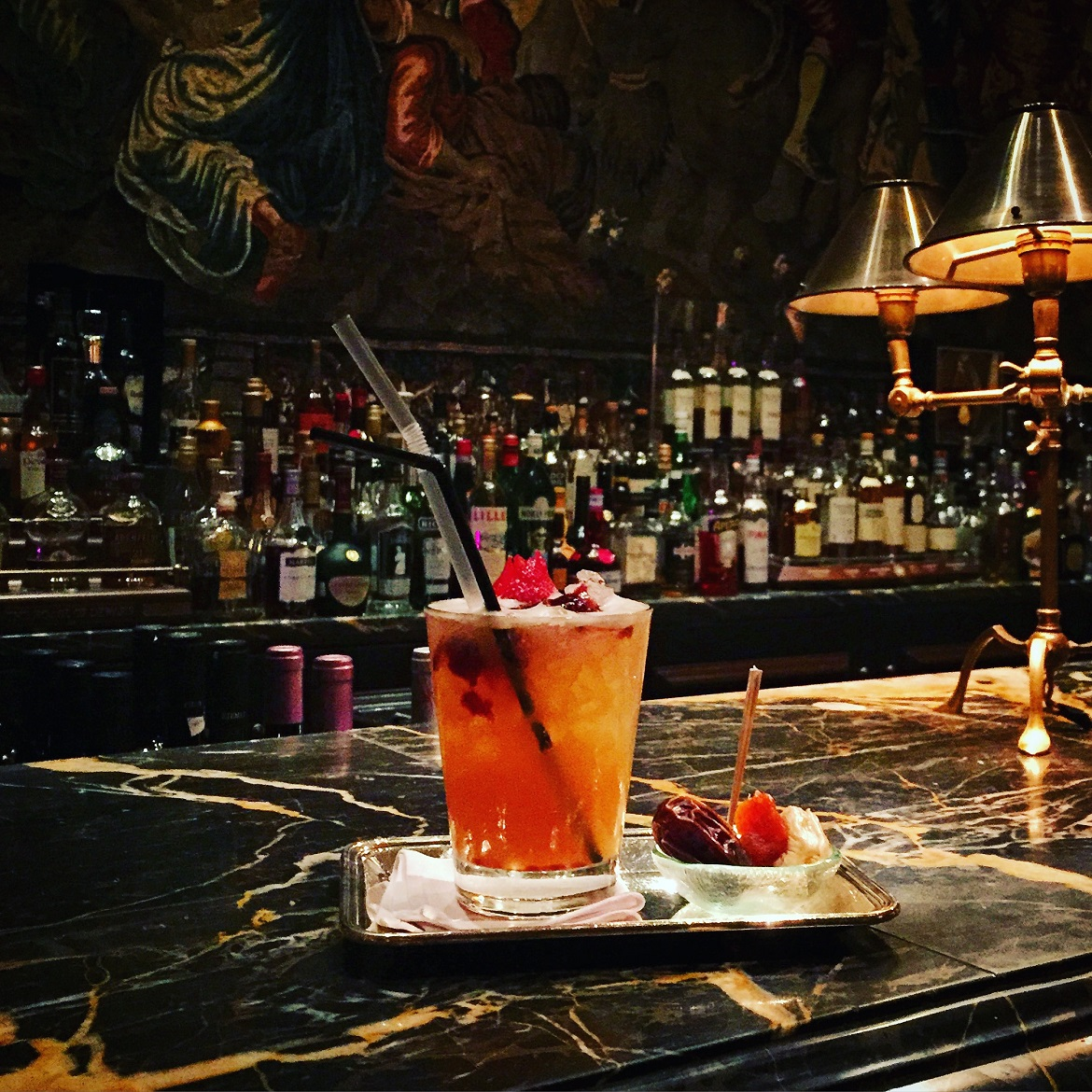 "A ""Rakoon"" perfectly served on the luxurious marble bar of Alexander's bar."